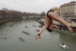 01-italys-marco-fois-dives-into-the-tiber-river-from-the-18-meter-59-feet-high-cavour-bridge-in-rome-sunday-jan-1-2012-to-celebrate-the-new-year