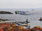 02-the-cruise-ship-costa-concordia-sinking-at-the-shores-of-giglio-porto-italy