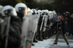 07-a-protester-gestures-at-riot-police-during-clashes-outside-the-greek-parliament-in-athens