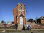 10-residents-look-over-the-remains-of-st-josephs-catholic-church-in-ridgeway-illinois-destroyed-after-it-was-struck-by-a-tornado