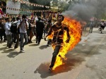 13-a-tibetan-activist-screams-as-he-runs-engulfed-in-flames-after-self-immolating-at-a-protest-in-new-delhi-india-ahead-of-chinese-president-hu-jintaos-visit-to-the-country