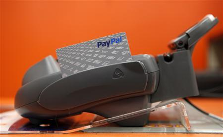 A PayPal card sits at a cashier station at a Home Depot store in Daly City