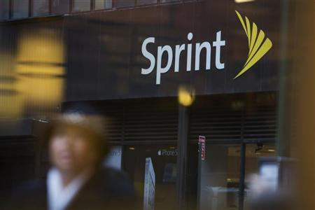 People walk past a Sprint store in New York