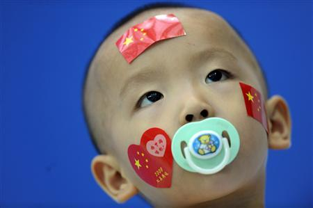 File photo of a child watching the diving competition at the National Aquatics Center during the Beijing 2008 Olympic Games