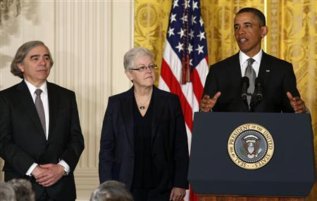 U.S. President Barack Obama stands next to two new nominees for his staff in Washington