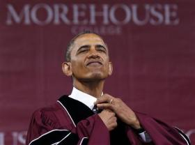 U.S. President Obama adjusts his tie before receiving honorary Doctor of Laws degree at graduation ceremony of class of 2013 at Morehouse College in Atlanta