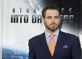 "Actor Chris Pine, cast member of the new film ""Star Trek Into Darkness"", poses as he arrives at the film's premiere in Hollywood"